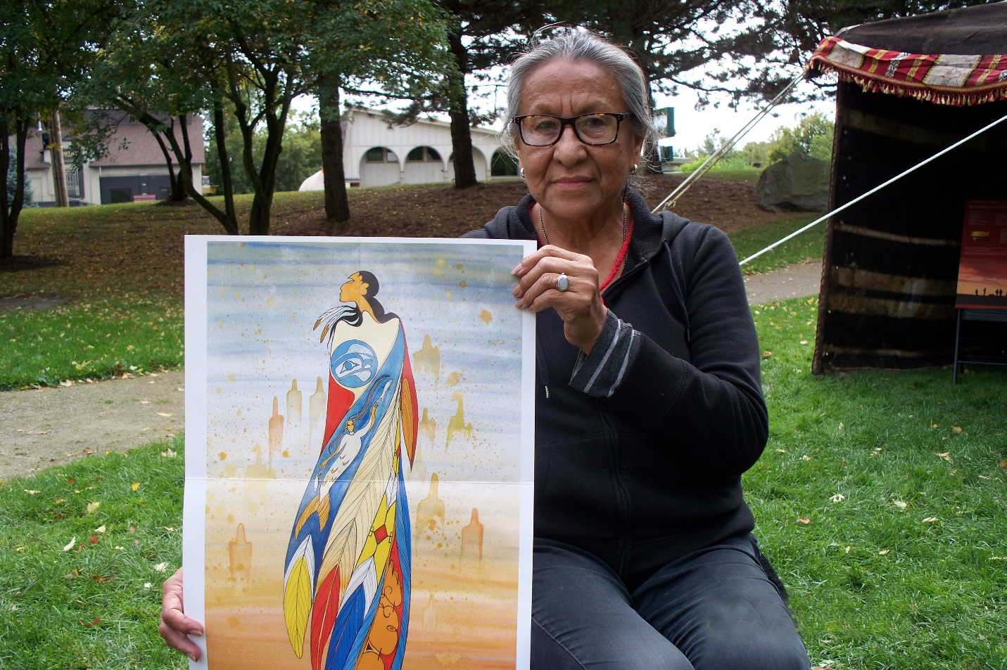 "Maxine Noel with her art ""Not Forgotten"""
