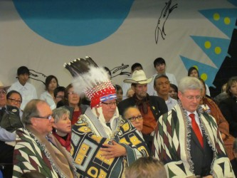 Prime Minister Stephen Harper (right), Blood Tribe Chief Charles Weaselhead (cen