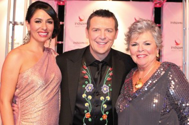 Carmen Moore (left) and Theo Fleury, with CEO Roberta Jamieson