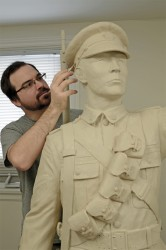 Tyler Fauvelle works on his sculpture of Francis Pegahmagabow