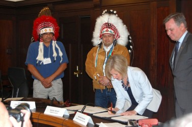 Premier Rachel Notley signs the protocol agreement Tuesday morning